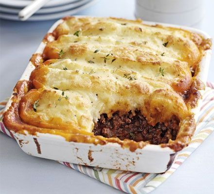 Cottage Pie With Olive Oil, Beef, Onions, Carrots, Celery Sticks, Garlic Cloves, Plain Flour, Tomatoes, Red Wine, Beef Stock, Worcestershire Sauce, Thyme, Bay Leaves, Potatoes, Milk, Butter, Cheddar Cheese, Grated Nutmeg