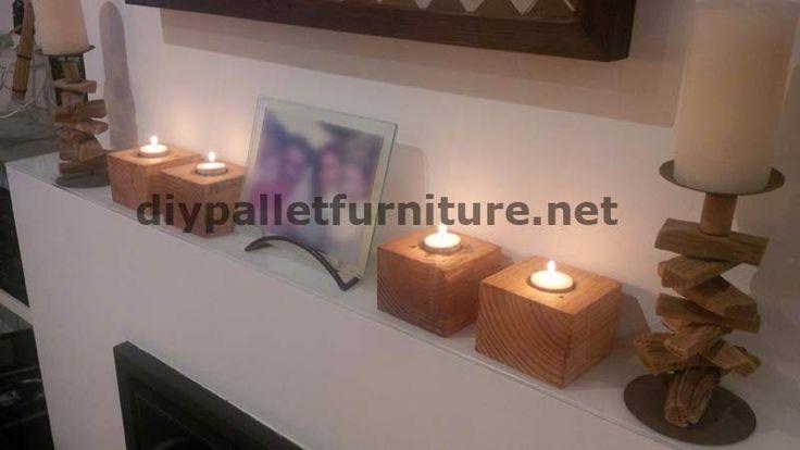 Pequeños candelabros hechos con tacos de palets