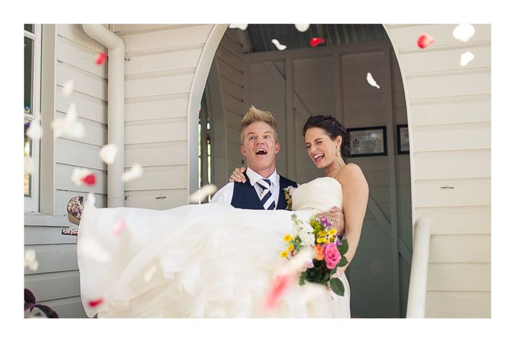 Wedding in port douglas! Lovely idea for ceremony exit with rosepetals