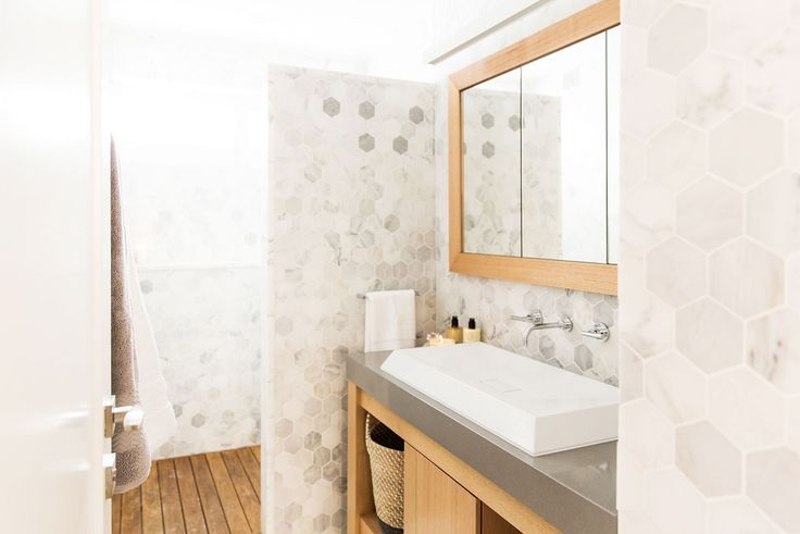 This stylish bathroom was created by Ayden & Jess from The Block Triple Threat. It features the Mos Calcatta Hex feature tile with Ottimo Super Polished. For more bathroom ideas visit: http://www.beaumont-tiles.com.au/Room-Ideas/Bathrooms