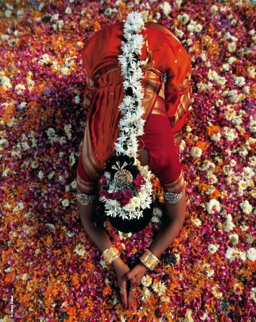 Flowers offering during praying Time in India
