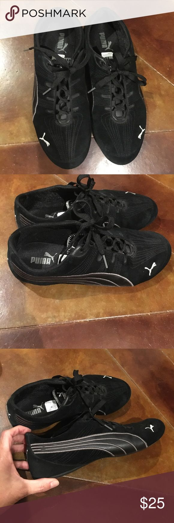 Size 8 1/2 black puma tennis shoes Like new black puma tennis shoes. Suede material with leather detail on side. Puma Shoes Sneakers