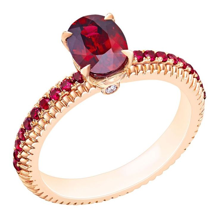 @faberge engagement ring featuring rubies in a delicate, fluted setting with matching pavé gems (£7,330).