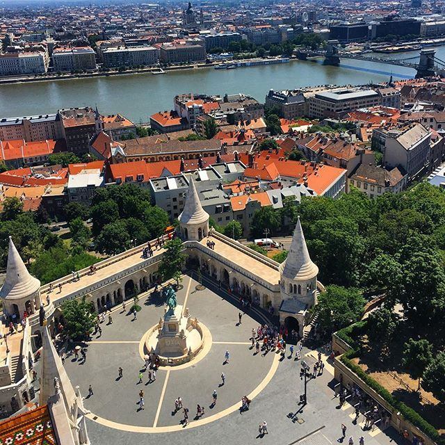 Climb the 200 stairs up to the top of the tower of St. Matthias Church for an amazing view of the city and the Fisherman's Bastion #fishermansbastion #travelbudapest #aerialview #churchtower  #traveltheworld #stmatthiaschurchbudapest #sightseeing #tourists
