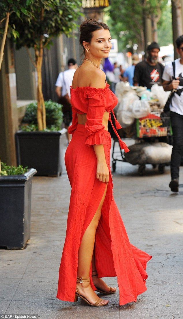 Trim and toned: Emily highlighted her tiny waist in the bardot top, with ruffled detailing and bell sleeves adding a bohemian feel to the look
