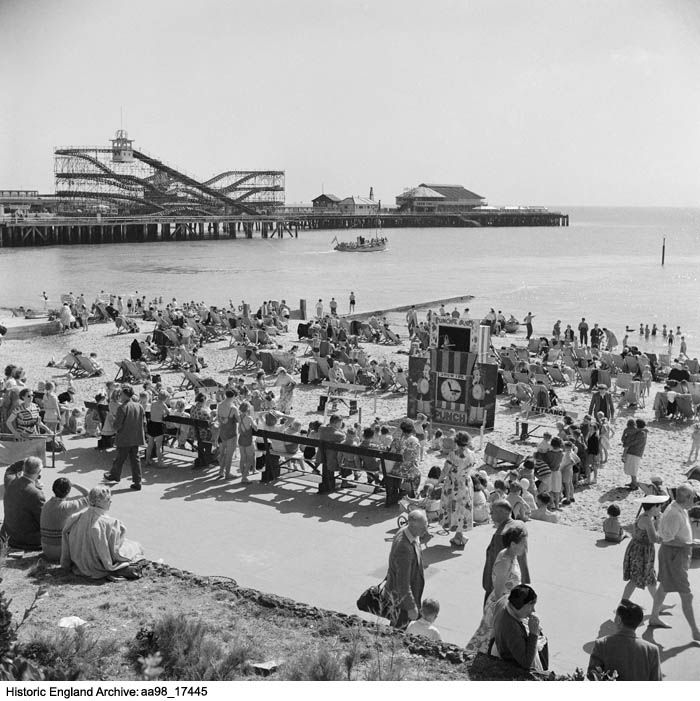 AA98/17445 A general view of the beach at Clacton on Sea, Essex, with a Punch and Judy show on the sand. Photographed by Hallam Ashley in 1953. Click for more information or to search the collection.