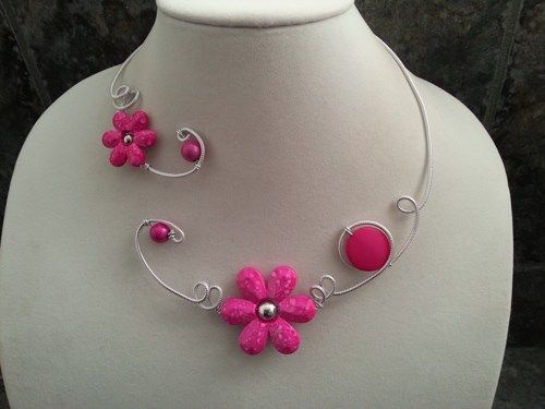 Here is a necklace that will turn eyes on you.  It's an open collar necklace, one-of-a-kind. Made with silver aluminium wire and acrylic flowers and beads in fuchsia color.  If you need earings, infor