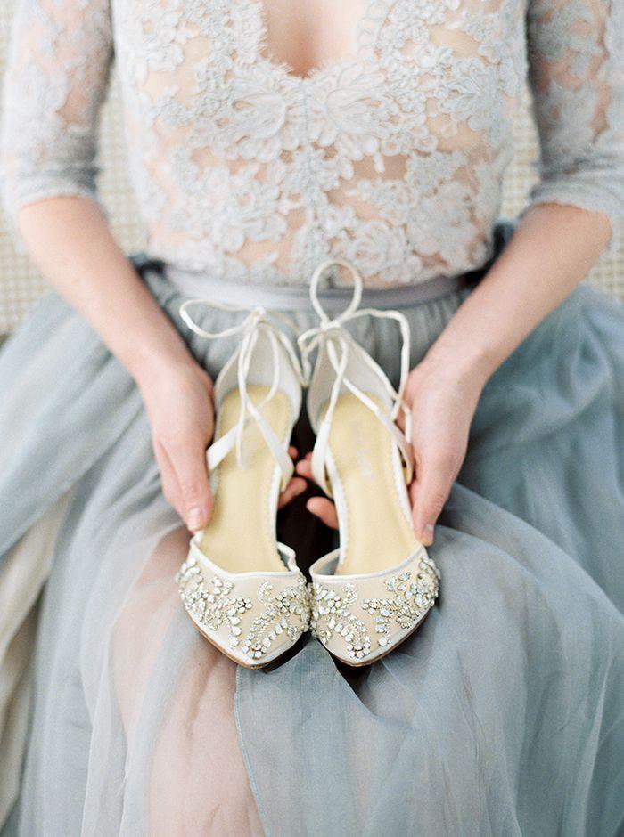 Sheer Tulle and Lace Wedding Dress with Crystal Heels  https://heyweddinglady.com/moody-blues-grays-southern-barn-wedding/    #wedding #weddings   #weddinginspiration #bluewedding #barnwedding #weddingdress #coloredweddingdress #shoes #heels
