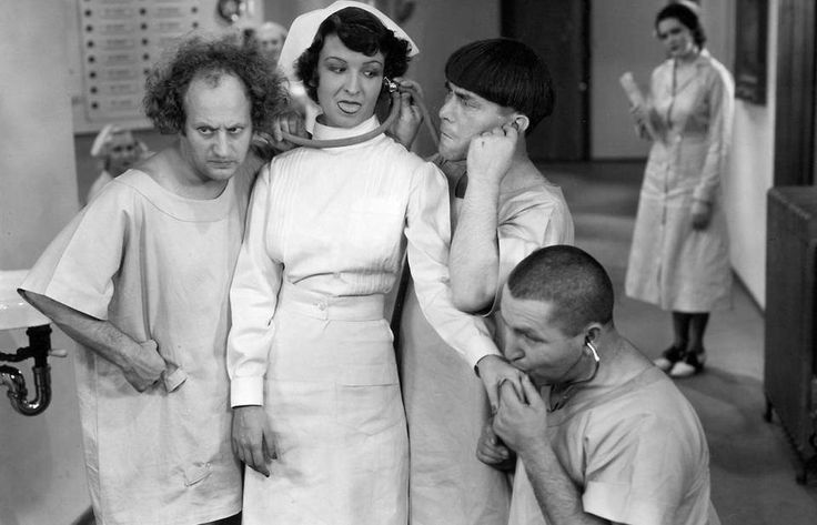 A rare press shot of comic legends' The Three Stooges examining co-star Jeanie Roberts ( hiccupping nurse ) for the 1934 comedy classic, MEN IN BLACK!