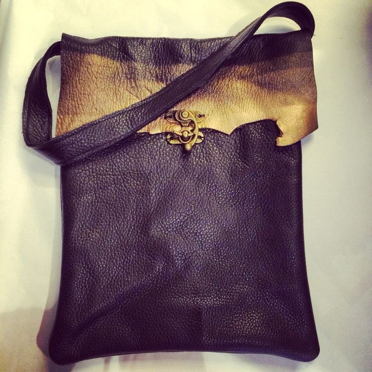 Black and gold metallic purse, hand bag made from scrap leather. Has a metal hook closure.