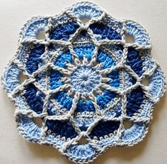 A mandala in cool blues with a trellis of overlay.