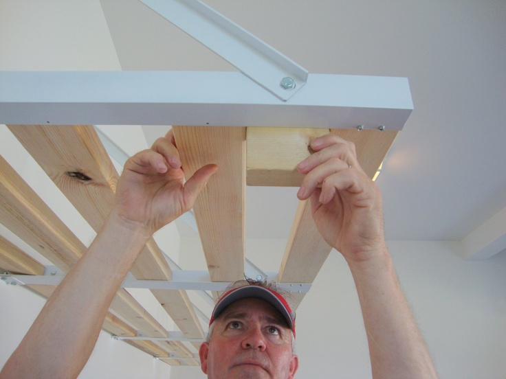 Easy installation of a Rhino Shelf garage storage kit.  Super easy to install!
