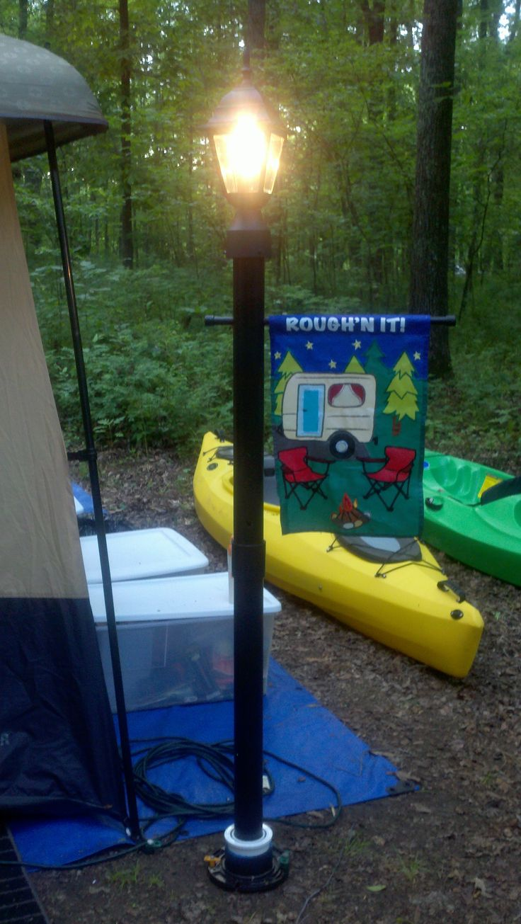 Every campsite NEEDS a lamp post.  My 13 year old son made this for me!  It is my FAVORITE piece of camping equipment!!