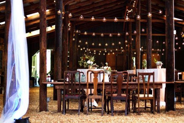 rustic farm wedding reception | Barn wedding reception with wooden chairs and farm tables. { via }