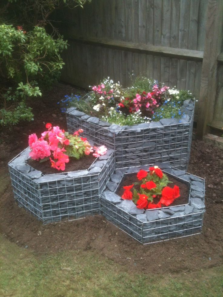 a three tier hexagonal gabion planter created from three hexagonal planters of different heights to