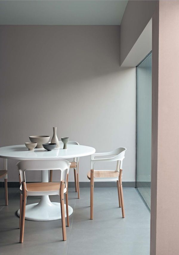 Beautiful muted palette in this dining room. Love the round dining table.
