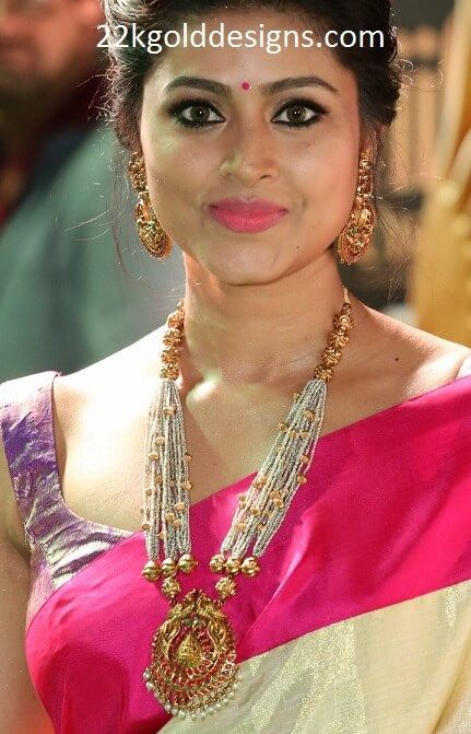Sneha in Antique Pearl Long Necklace