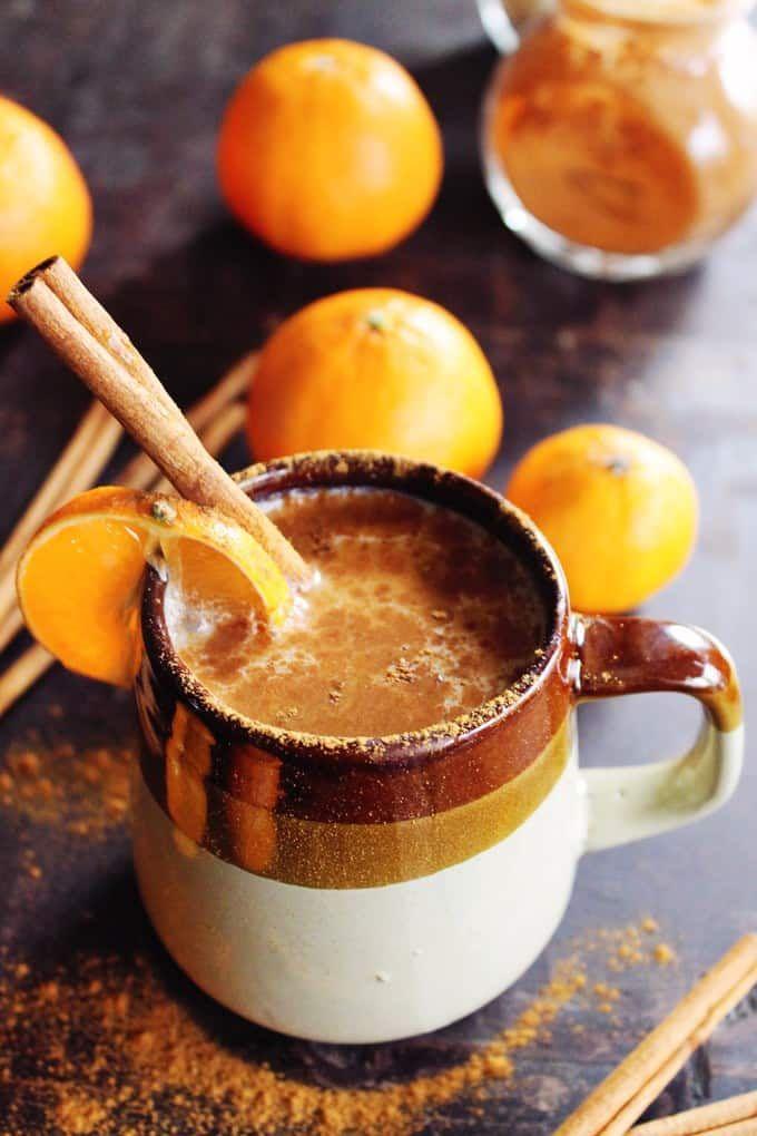 Almond Milk Chai Whiskey Orange drink on table