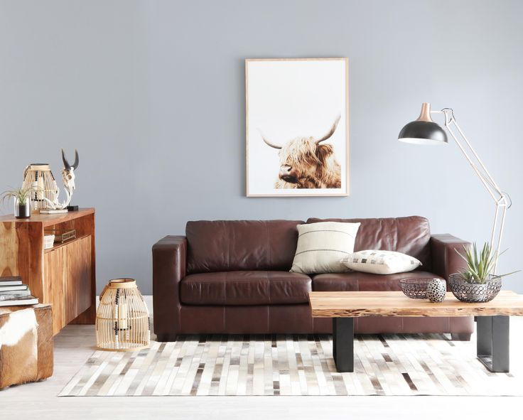 Gordon sofa with live edge coffee table and buffet. Sly floor lamp is also featured