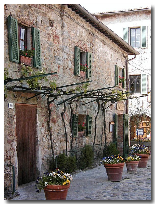 An old house in Monteriggioni. This very well preserved medieval village was founded in 1203.