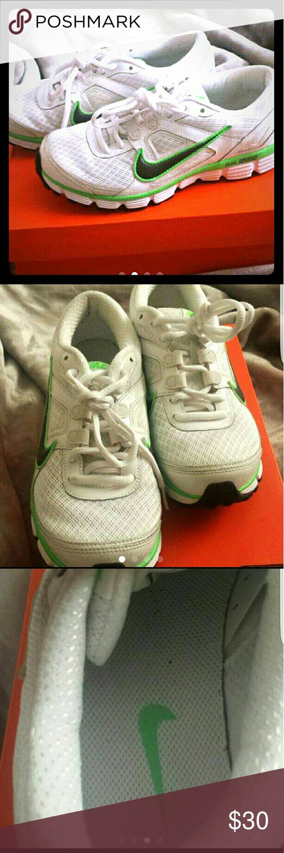 Women's Nike Dual Fusion White and green running shoes. Great condition! There is no wear on the tread at all as you can see from the last picture. The white is still white no yellowing. They are too big so I only wore them a few times! Nike Shoes