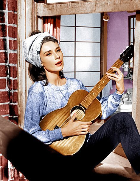 Audrey Hepburn singing 'Moon River' on her apartment balcony in 'Breakfast at Tiffanys'