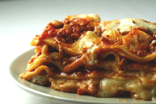Lasagna Bolognese | This hearty lasagna can be prepared ahead of time and baked just before serving. | Rich and hearty, this is a traditional lasagna recipe typical of old country Italian cooking.  I often make two lasagnas at one time, and freeze the second one for later. Simply allow the fozen lasagna to thaw completely before