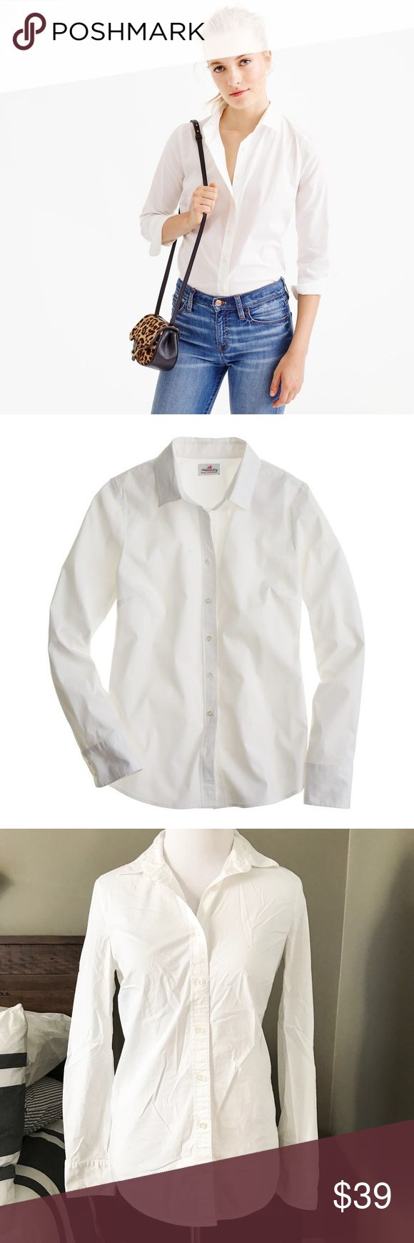 J. Crew Stretch Perfect Shirt in White Classic crisp Button Down Shirt from J. Crew. Perfectly tailored for a flattering fit. These button downs are a staple in my closet. They machine wash well and they fit amazing! Size XS. Excellent condition. No flaws. No stains. Currently full price on the website. J. Crew Tops Button Down Shirts