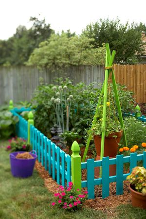 garden with bright picket fences - easy way to add colour