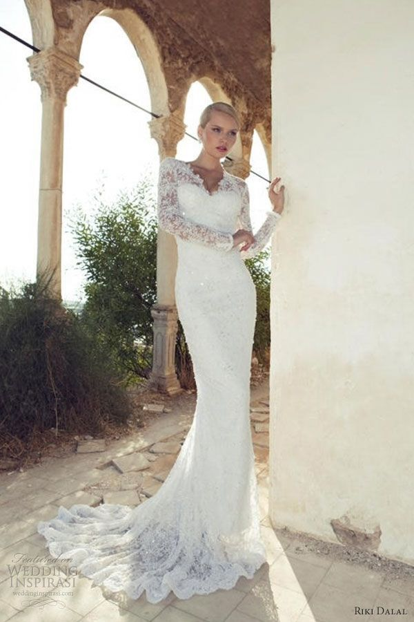 Lace form fitting long sleeve wedding dress