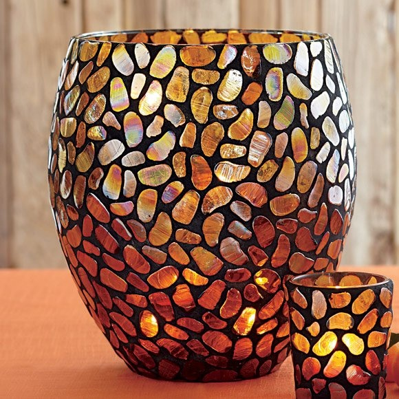 """Aurora Mosaic Hurricane - Pebble-shaped mosaic glass tiles are carefully hand-applied to create an artistic, organic pattern. Specialty finish glows with an iridescent golden shimmer when lit with a pillar candle, tealight tree, large tealight, or votive in votive cup, all sold separately. Includes leveling beads to stabilize pillar. 9 1/2"""" h, 6 3/4"""" top dia.http://www.partylite.biz/sites/briteflames/productcatalog"""