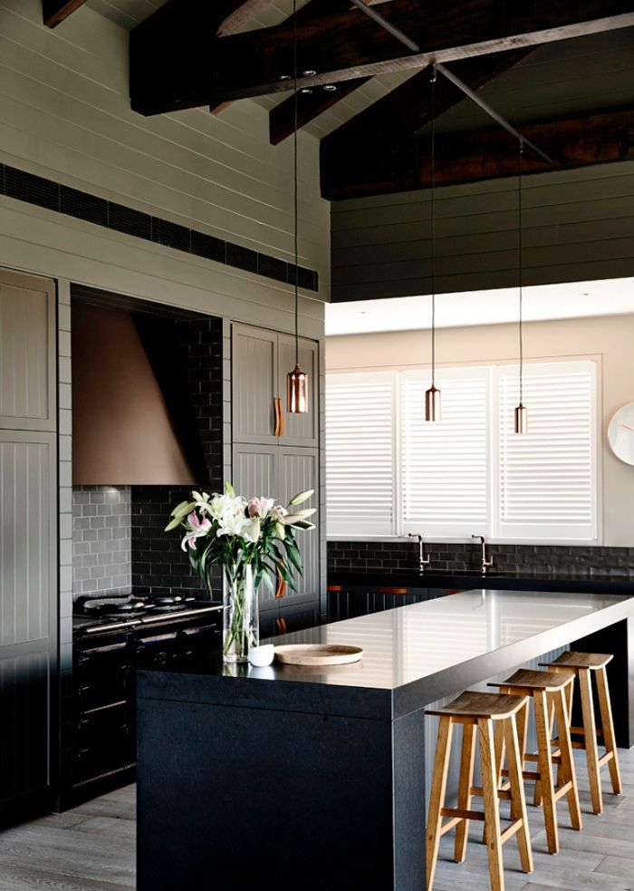 A stylish contemporary farm house nestled inthe hill's of the Mornington Peninsula, near Melbourne. Withshiplap cladding onthe walls and ceilings, exposed beams and a moody black, charcoal& taupe color scheme. The kitchen is gorgeous with panelled cabinetry and leather pulls, and the floor to ceiling chevron tiling in the bathroom is stunning.Renovation byCanny Architecture ~ …