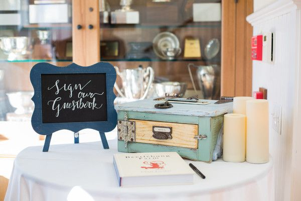 Unique guestbook idea - guests were asked to sign a cookbook displayed with a modern calligraphy sign {Ashley Tilton Photography}