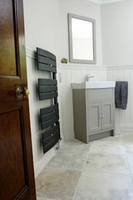 Black bathroom towel radiator: modern Bathroom by Mr Central Heating