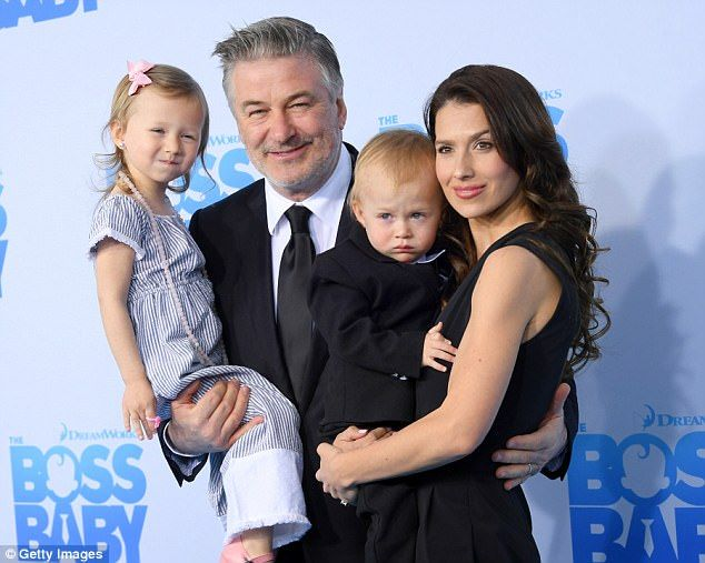 Family man: Alec Baldwin has lent his voice to The Boss Baby, a movie about a tot and his older brother teaming up to stop a CEO (pictured with wife Hilaria Baldwin, daughter Carmen, and son Rafael in March)