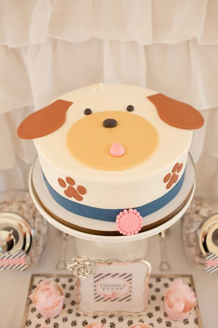 What an adorable cake at a Puppy party!  See more party ideas at CatchMyParty.com!  #puppy #partyideas