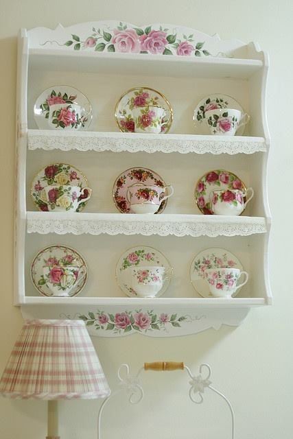 Cups and saucers with roses