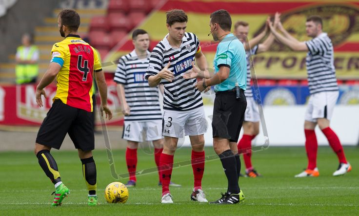 Queen's Park's Sean Burns shakes hands with referee Andrew Dallas during the Betfred Cup game between Partick Thistle and Queen's Park.