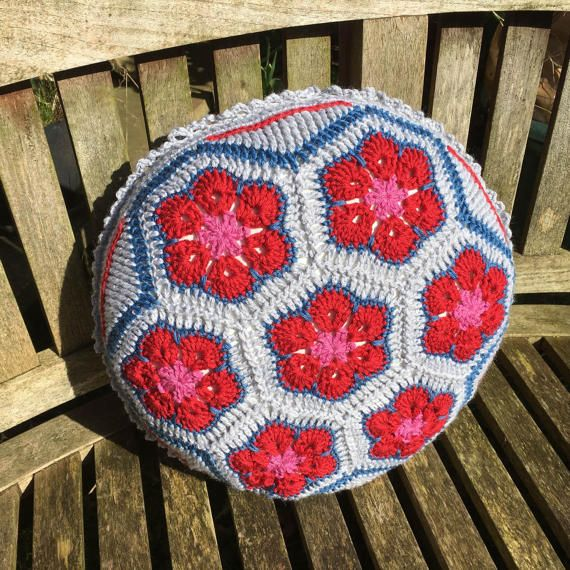 African flower and mandala inspired crocheted merino wool red