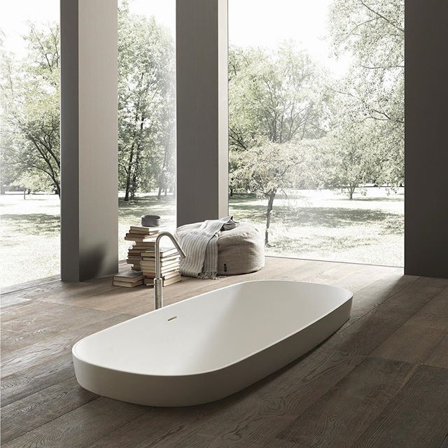 Incredible bathroom simplicity featuring luxurious thermoformed bathtub. By Modulnova.  Exclusively available in Australia at The Nest 45. A stunning range of design options are available - link in bio.