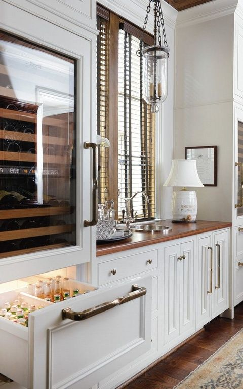 """A refrigerator DRAWER would be pretty ideal for fitting more beer bottles! Traditional Bar with Subzero - 27"""" integrated wine storage with refrigerator drawers - panel ready, Hardwood floors"""