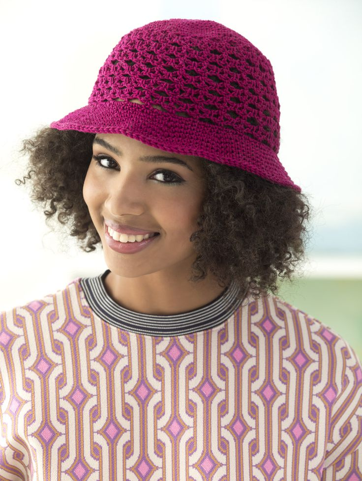 Crochet this cute cotton sun hat with lion brand
