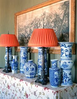 Love this pairing. Orange lamp shade on traditional blue and white lamp.