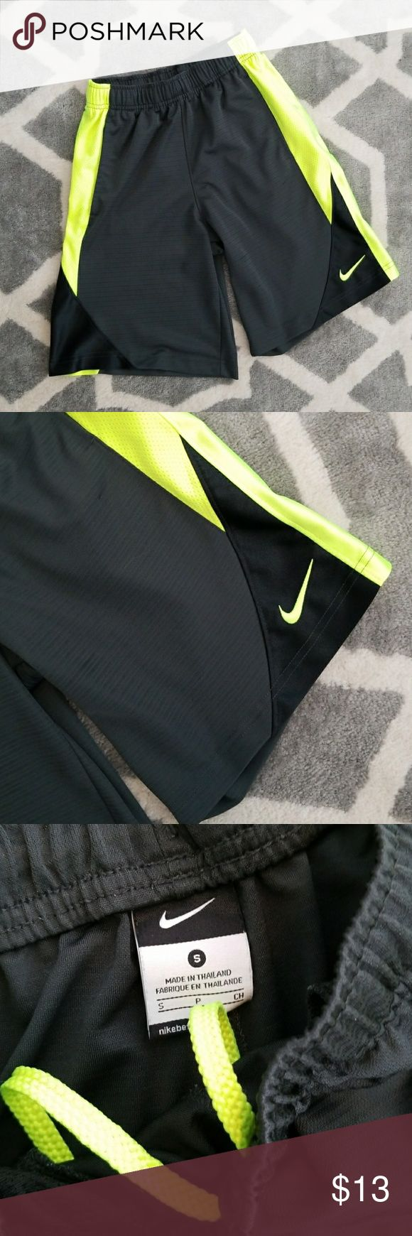 """Nike shorts Boys Nike shorts in excellent condition!! Size small with drawstring and pockets.  Dark gray with black and neon yellow accents!  9"""" inseam   Bundle for a discount!! Nike Bottoms Shorts"""