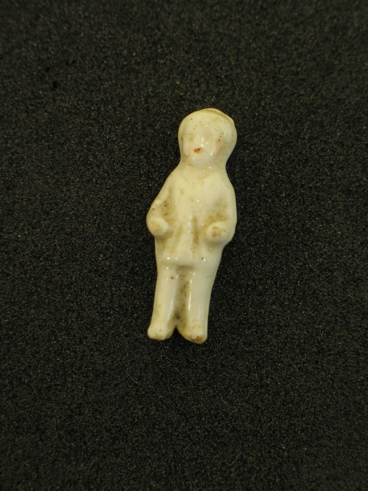 Porcelain doll found in plum puddings sent to New Zealand troops stationed at Gallipoli during World War One. From the collection of the Air Force Museum of New Zealand.