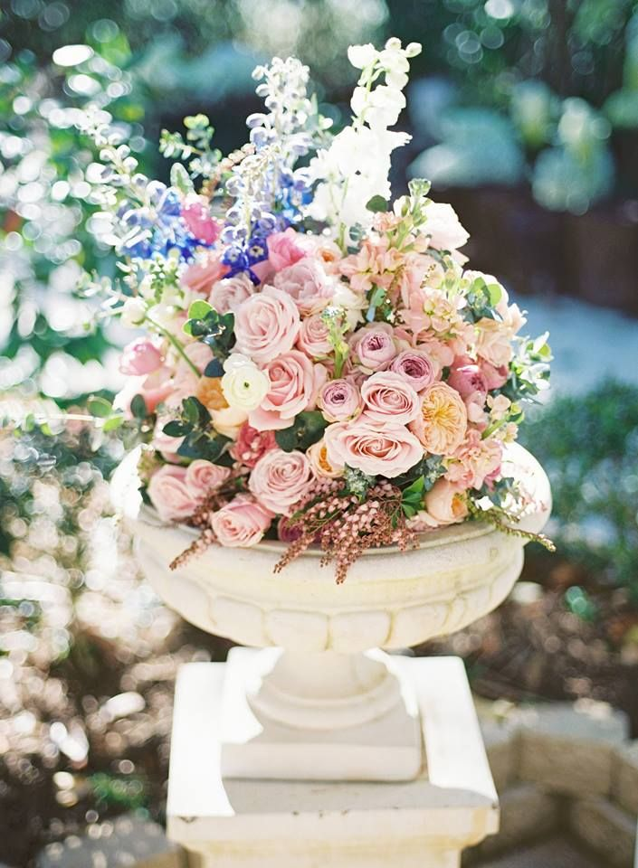 A concrete urn standing on its plinth make the perfect host for a bouquet of flowers.