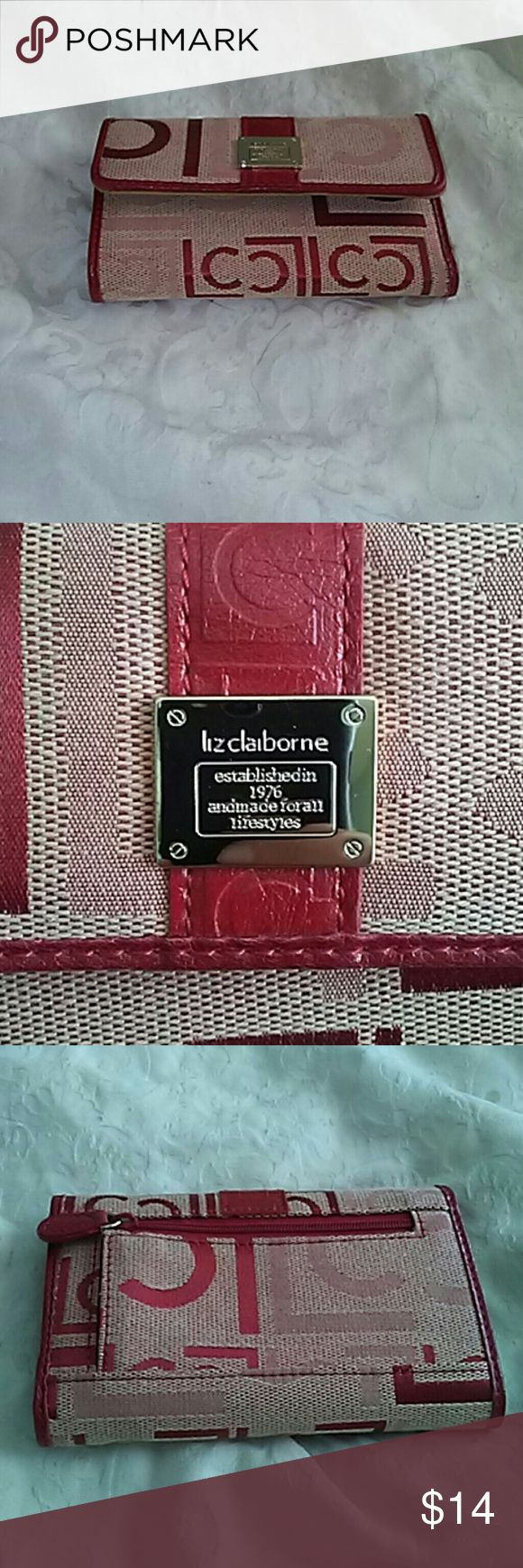 Liz Claiborne SALE!!!! Red wallet. Picture compartment, many credit card slots. Cute, never used. One shade off from the Liz Claiborne purse I have listed however you could never tell. The two are cute together. ***** make an offer to bundle with matching purse on page***** Liz Claiborne Bags Wallets