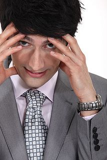 businessman with hands to forehead facing pressure by SalFalko, via Flickr