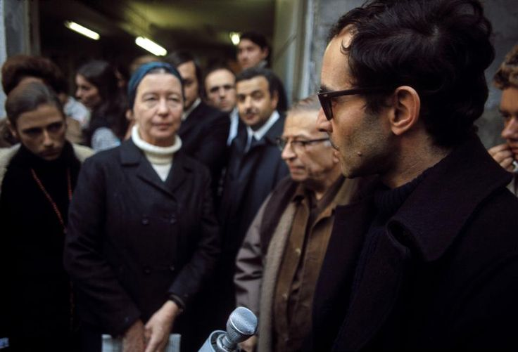 """Simone de Beauvoir, Jean-Paul Sartre and Jean-Luc Godard gather to distribute copies of the Maoist newspaper """"La Cause du Peuple"""" on the street after it is banned by the government,Paris, 1970.  [Credit:Bruno Barbey]"""