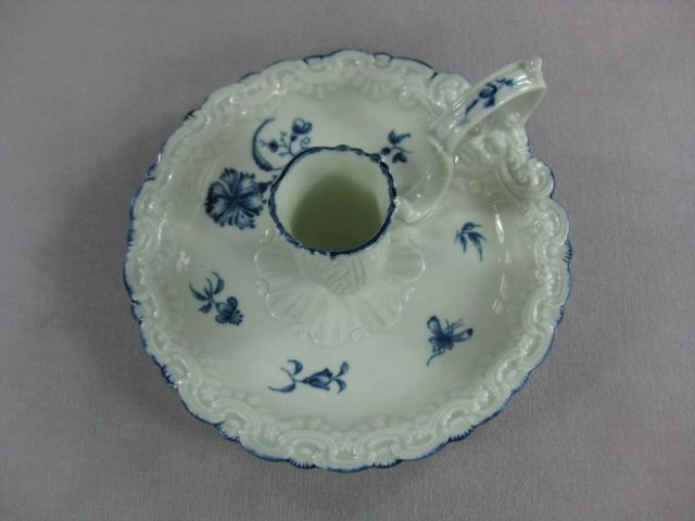 A rare Worcester blue and white  chamberstick decorated with the Gilliflower pattern and with a moulded edge and sconce and moulded face to base of handle . Script W mark  Circa 1765 Width 6""